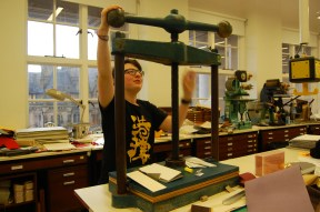 Hannah giving it a whirl on the nipping press. Photo taken by Daniella Carrington.